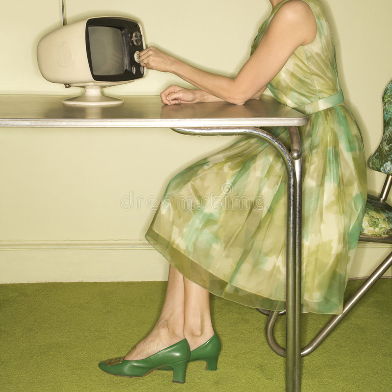 набирая женщина телевидения стоковое изображение
