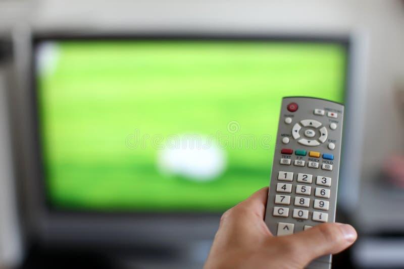 наблюдать tv стоковое фото rf