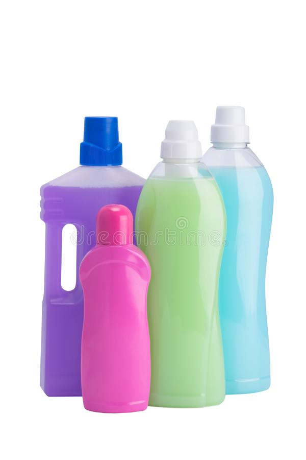Набор жидкостей для очищать и мыть в пестротканых бутылках, изолированных на белизне стоковые фотографии rf