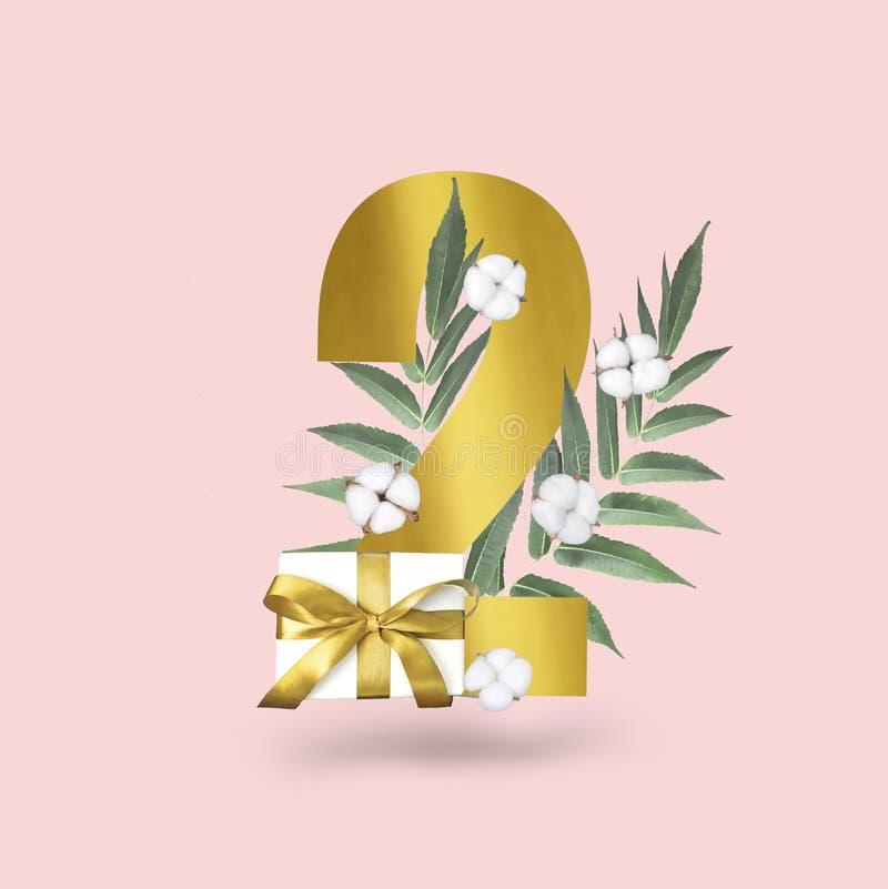Набор номера годовщины с подарочной коробкой, цветками хлопка, листьями и золотой текстурой стоковое фото rf