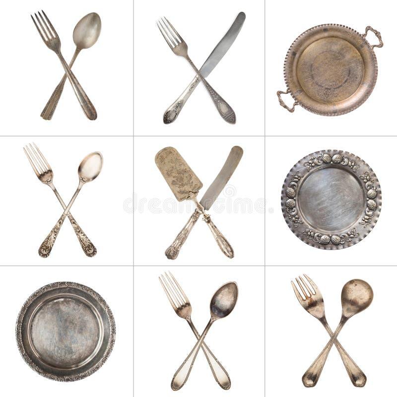 Набор пересеченных винтажных ложек, вилок, ножей и серебряных старых плит Изолировано на белизне пец ноги tac иллюстрации 3d tic стоковое изображение