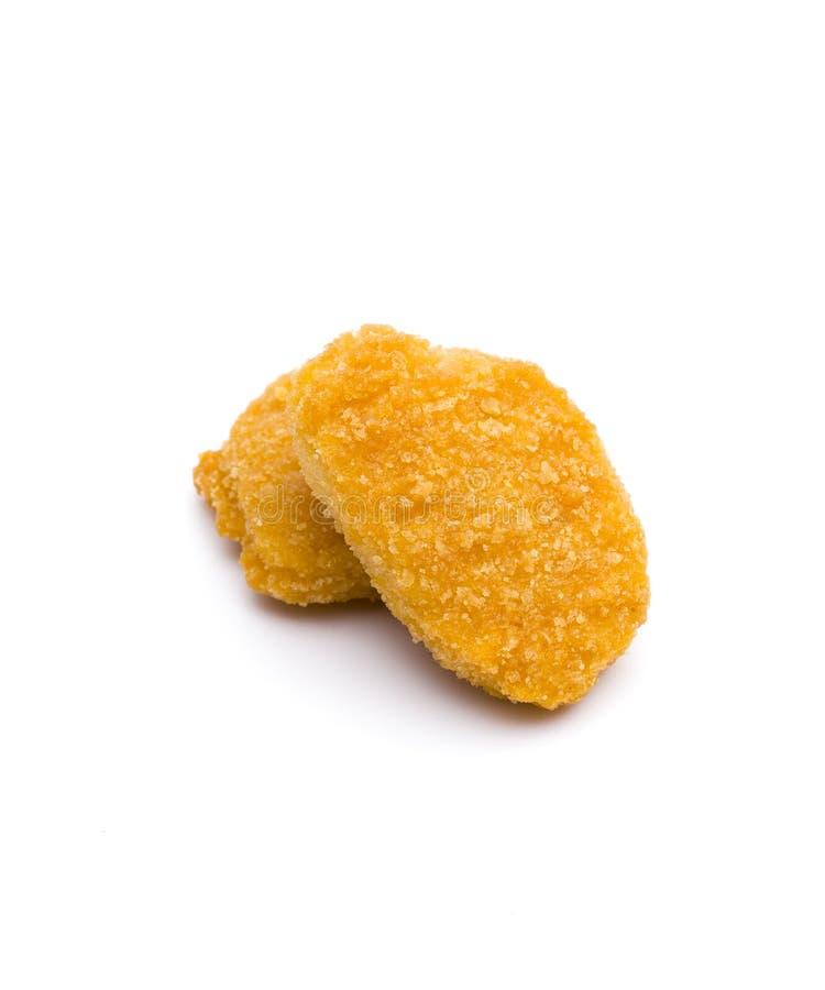 Наггеты цыпленка на белой предпосылке стоковая фотография