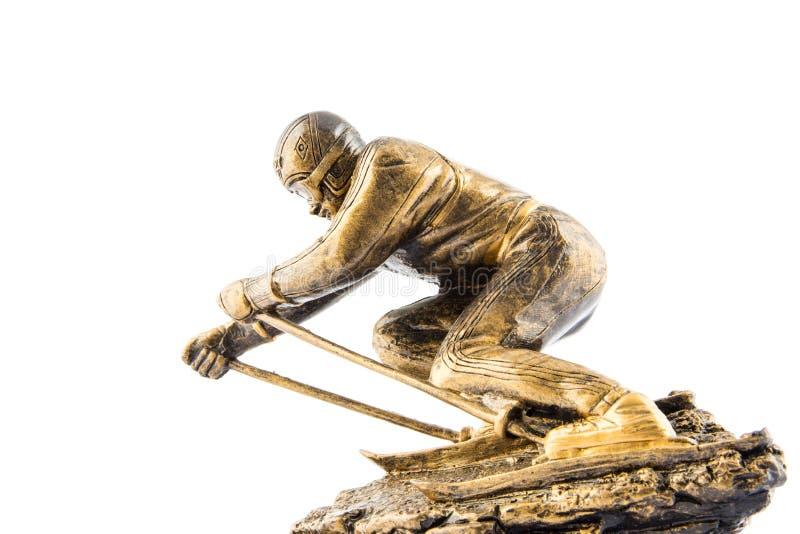 Награда статуэтки чемпиона лыжи золота стоковые фотографии rf