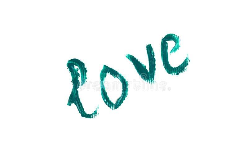 Надпись любит зеленую краску на белой предпосылке стоковая фотография rf