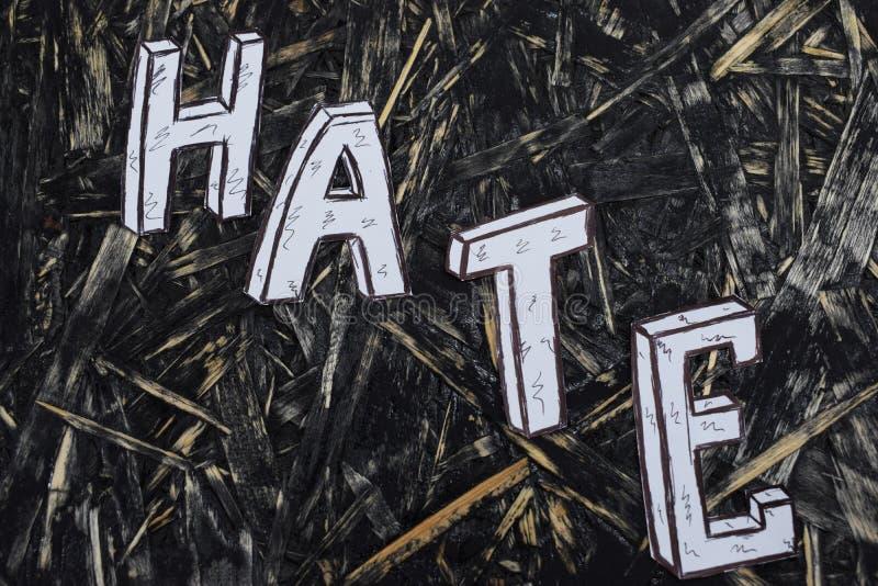 Надпись, ненависть, на предпосылке hernom с белыми письмами стоковое изображение