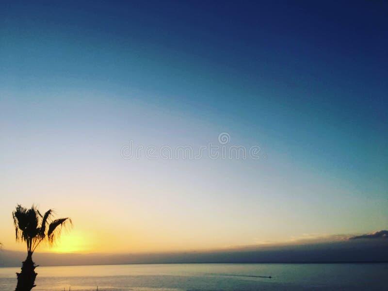 над заходом солнца восхода солнца моря стоковые фото