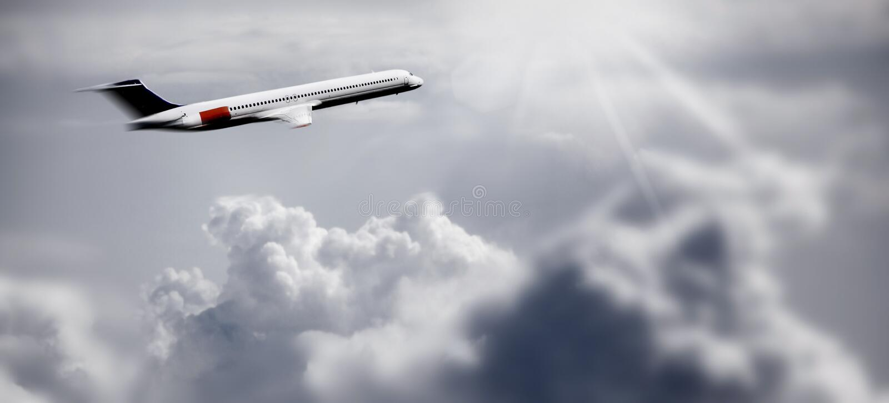 над облаками самолета стоковое фото rf