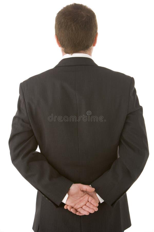 назад за бизнесменом вручает его удерживание стоковая фотография rf
