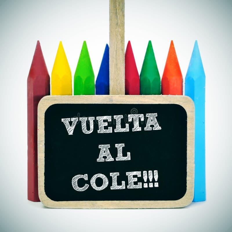 Назад к школе написанной в испанском языке: cole al vuelta стоковые изображения rf