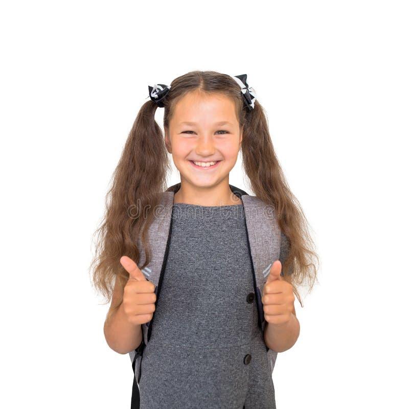 Назад к школе! Школьник показывает большие пальцы руки вверх стоковое изображение rf