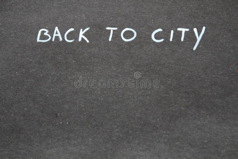 Назад к городу рукописно стоковое фото