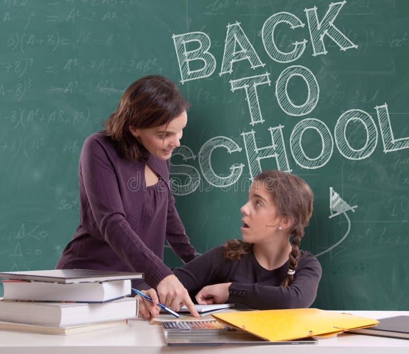 Назад к школе, зрачку и учителю стоковая фотография