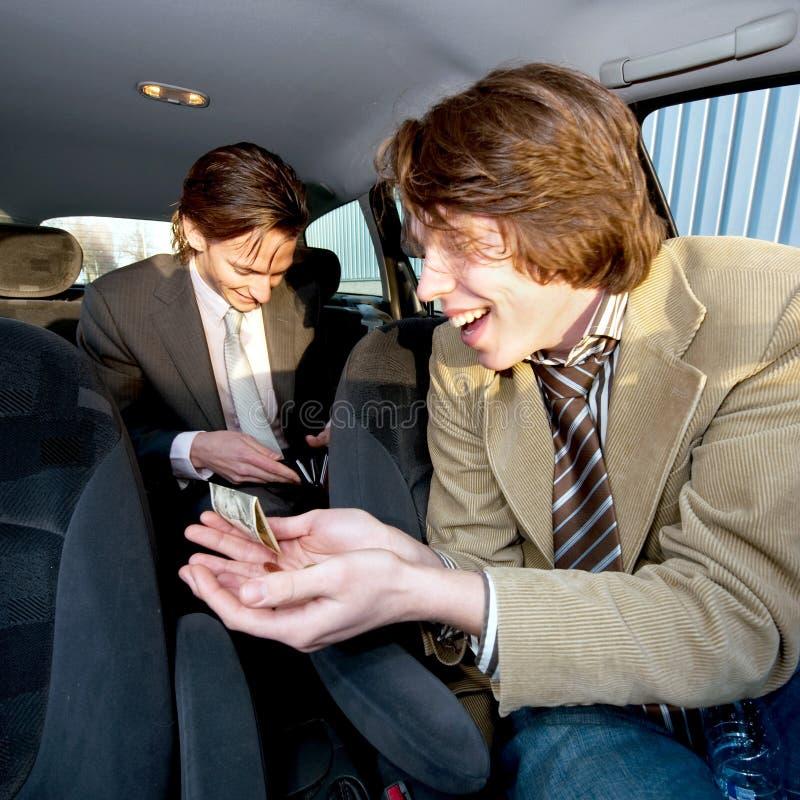 наклонять таксиста стоковое фото