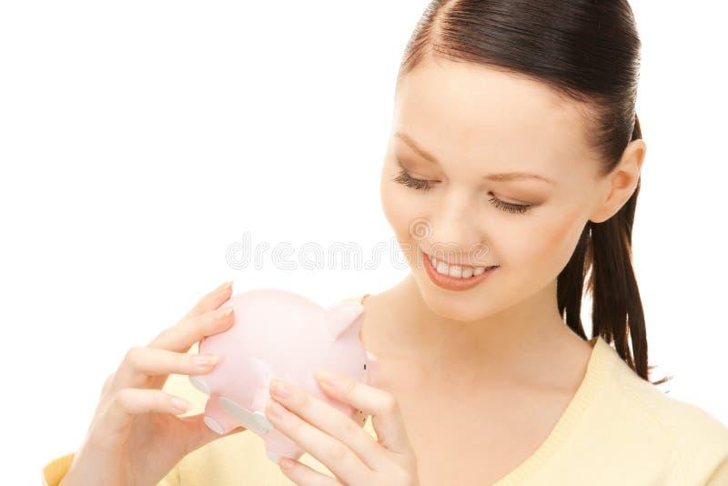 накрените симпатичная piggy женщина стоковое фото