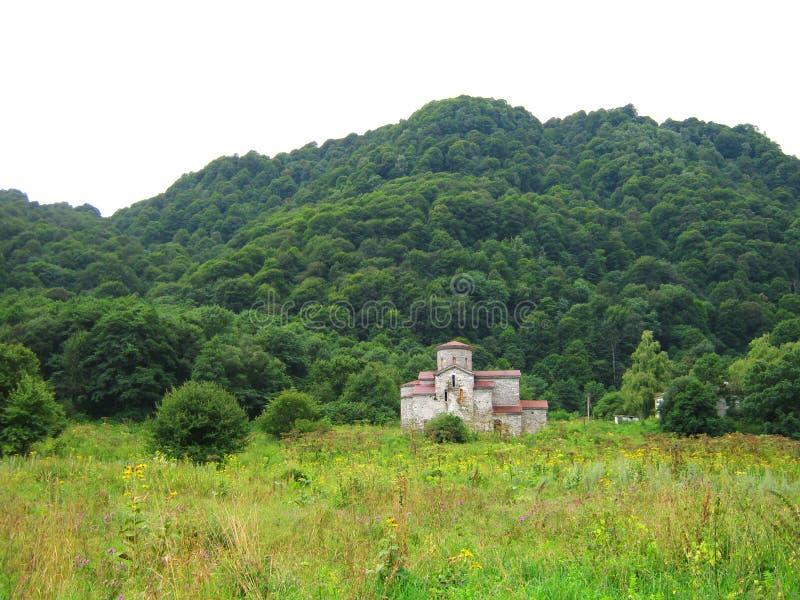 Наклон и замок горы стоковое фото