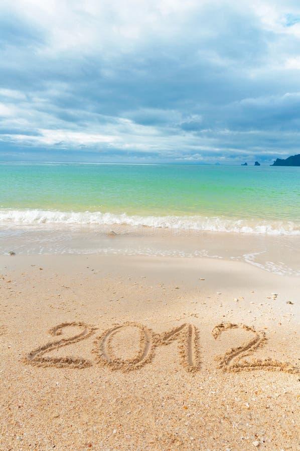 написанный песок 2012 праздника пляжа предпосылки стоковое фото