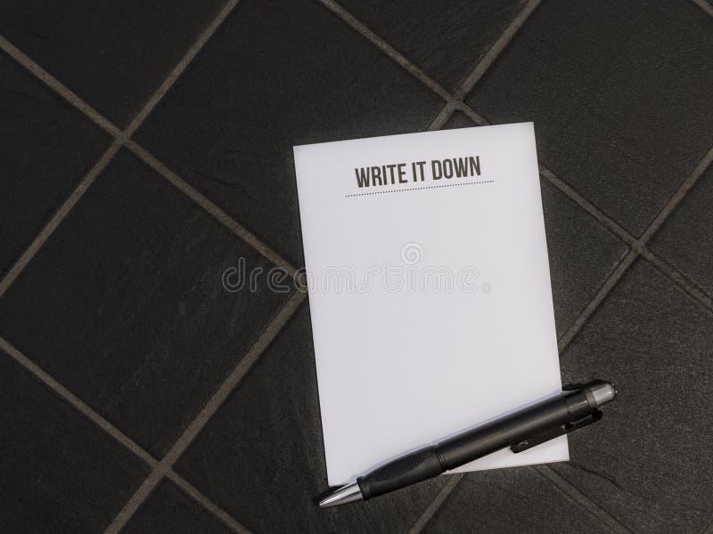 Напишите его вниз с блокнота стоковые изображения