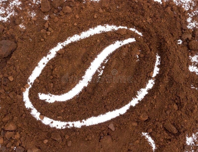 Нарисованная кофейная гуща форме логотипа кофейного зерна, shap кофейного зерна стоковые изображения