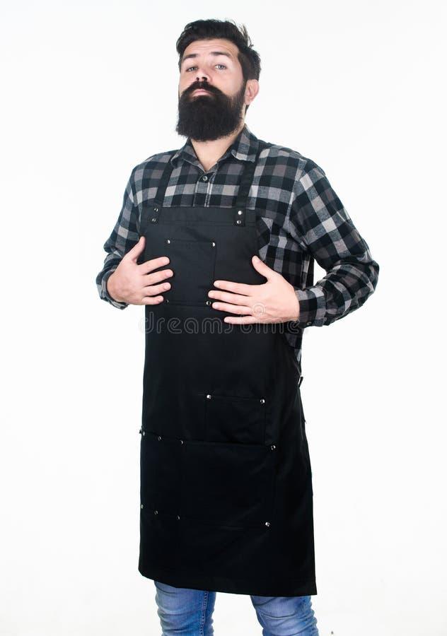 Наркомания работы Хипстер получая готовый для режима работы в парикмахерскае или кухне Рисберма работы бородатого человека нося с стоковые фото