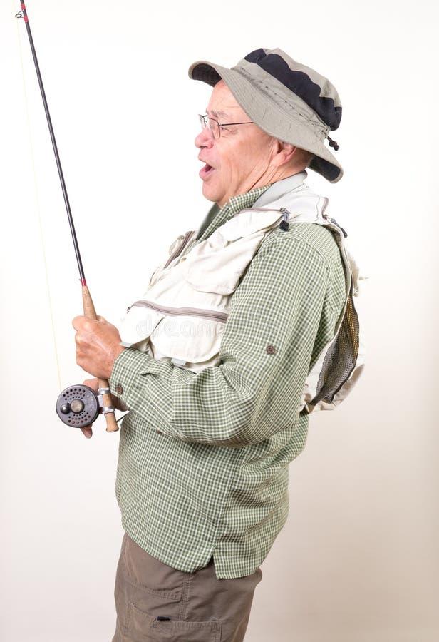 наслаждаться старшием выхода на пенсию мухы рыболова стоковые изображения rf