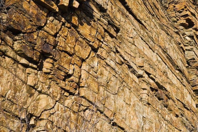 наслаивает желтый цвет стены песчаника стоковая фотография