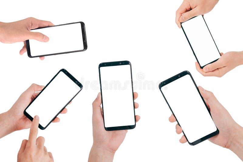 Насмешка Smartphone вверх, рука держа мобильный телефон при пустой экран изолированный на белой предпосылке с путем клиппирования стоковая фотография rf