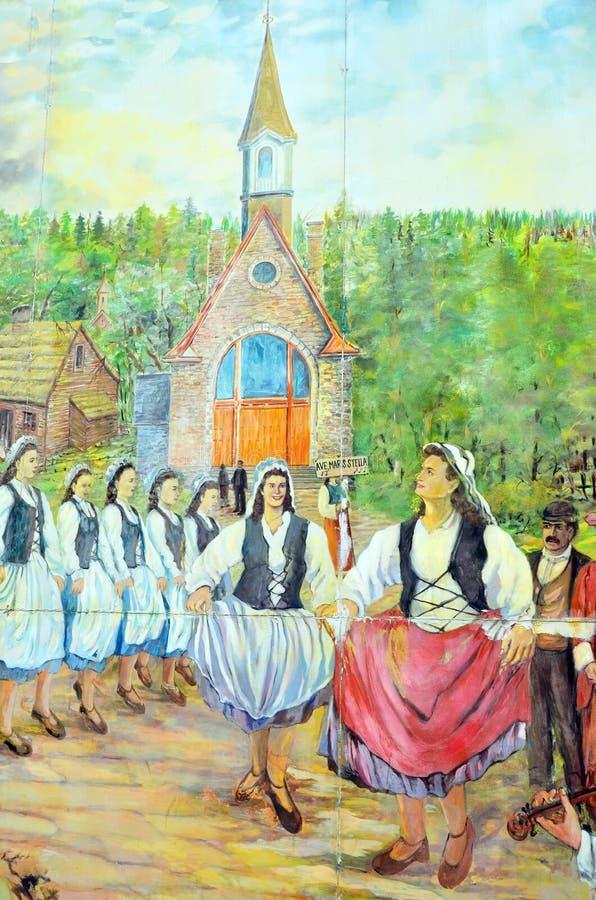 Настенная роспись говорит рассказ людей acadians стоковое изображение