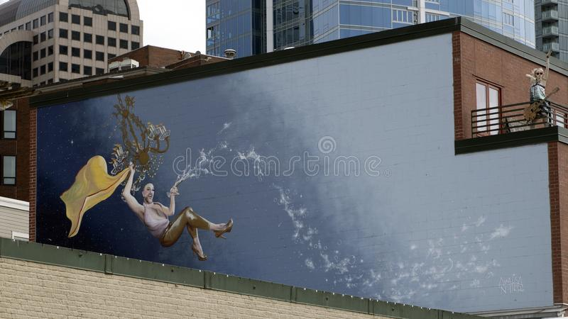 Настенная роспись луны Waxie художником Annalisa Notter над первоначально Starbucks в рынке места Pike, Сиэтл стоковое фото rf