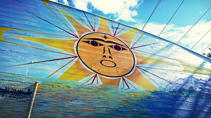 Настенная роспись сияющего солнца племенная стоковое фото rf