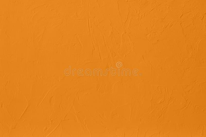насыщенная желтая покрашенная предпосылка низкого контраста конкретная текстурированная с шершавостью и незакономерностями стоковые фото