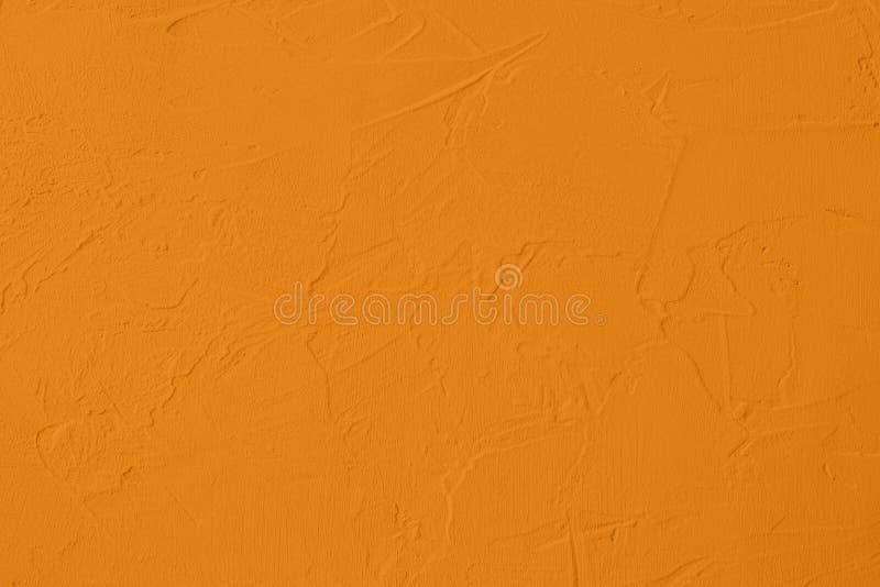 насыщенная желтая покрашенная предпосылка низкого контраста конкретная текстурированная с шершавостью и незакономерностями стоковая фотография