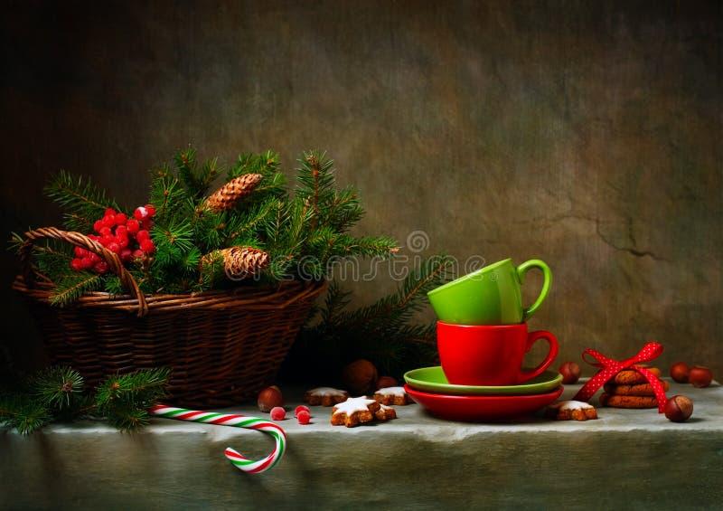 Натюрморт рождества с чашками и тросточкой конфеты стоковые изображения rf
