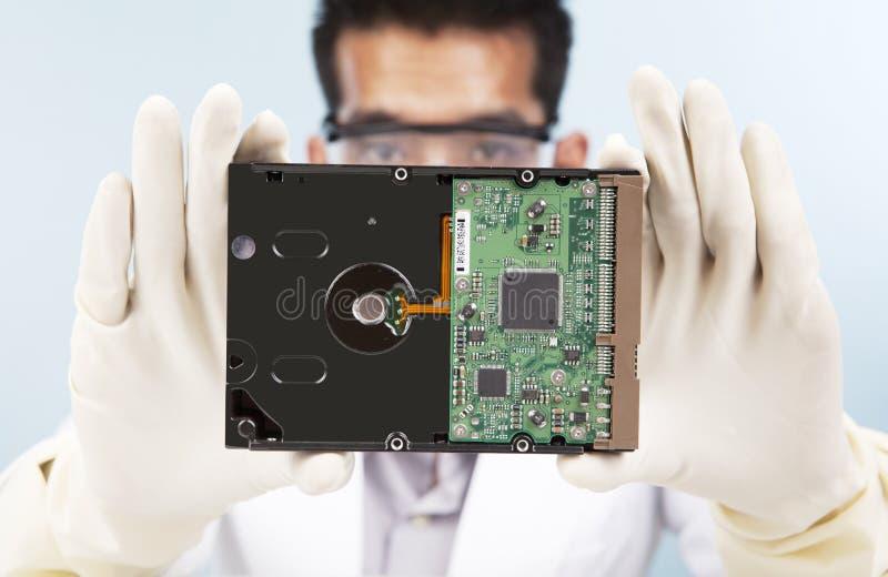 научный работник диска компьютера трудный стоковая фотография rf