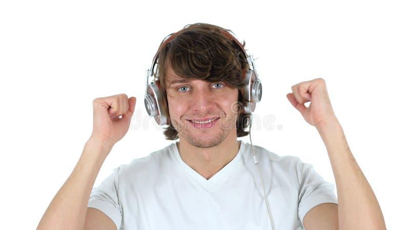 Наушники, музыка красивого человека слушая и танцевать стоковое изображение rf
