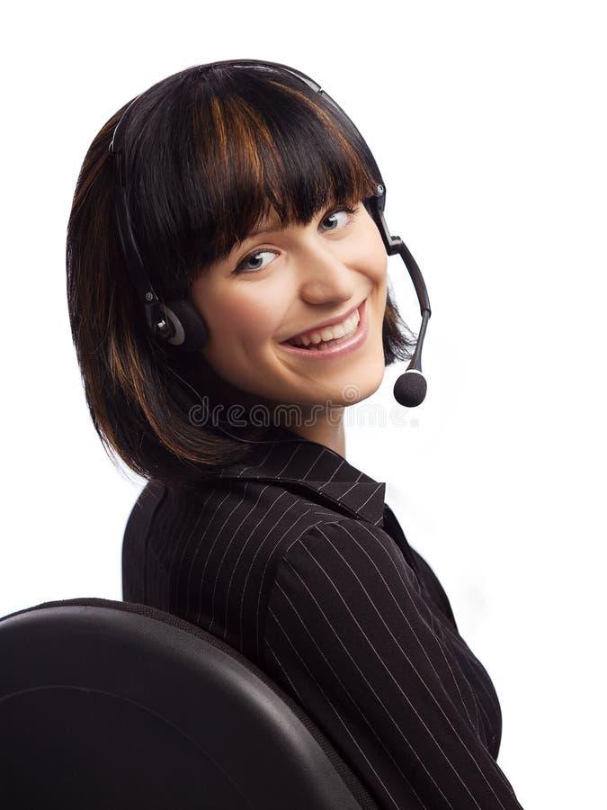 наушники стула брюнет усмехнулись женщина стоковое изображение