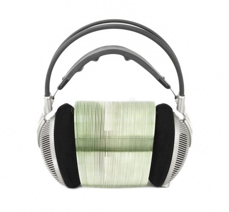 Наушники для слушать к музыке с КОМПАКТНЫМ ДИСКОМ мультимедиа/DVD стоковая фотография rf