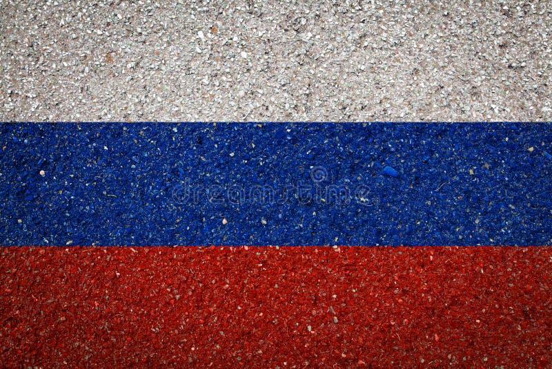 Национальный флаг на каменной предпосылке стоковое фото
