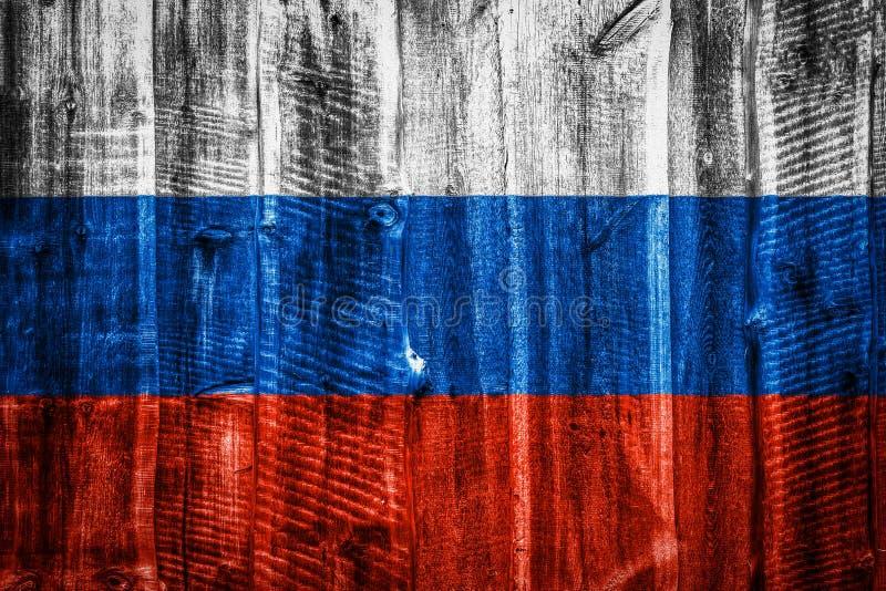 Национальный флаг на текстурной деревянной предпосылке стоковая фотография rf