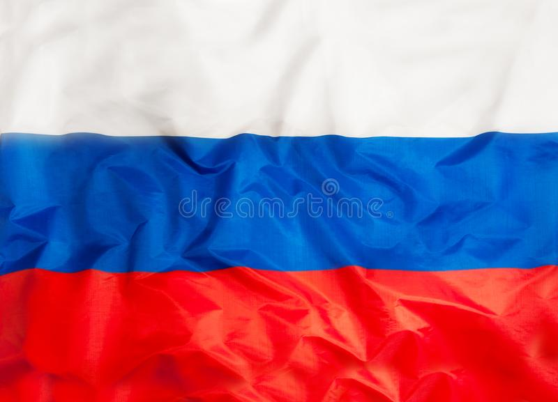 Национальный флаг России с развевая тканью стоковое изображение rf