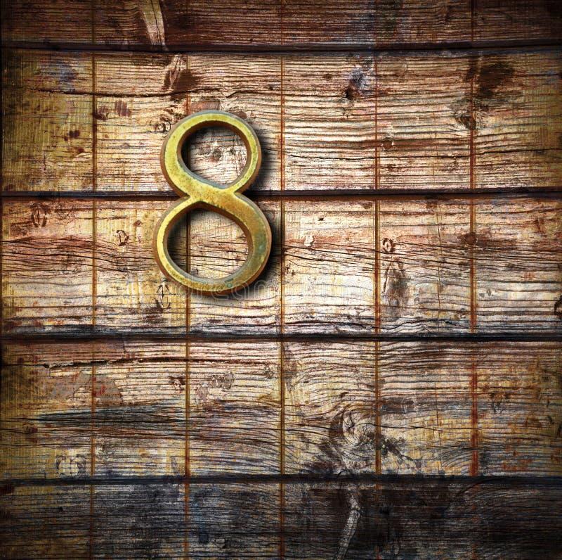 8 на деревянной предпосылке стоковое изображение rf