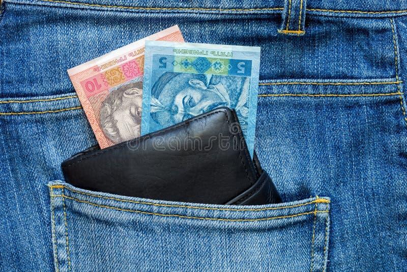 Наличные деньги смотрят из портмона стоковые фотографии rf