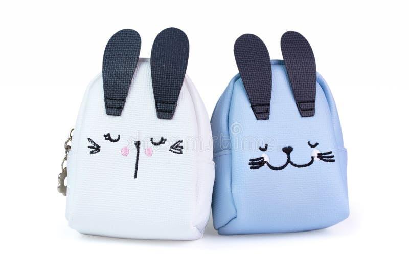 Небольшие сумки для детей в форме кроликов цвета стоковое фото rf