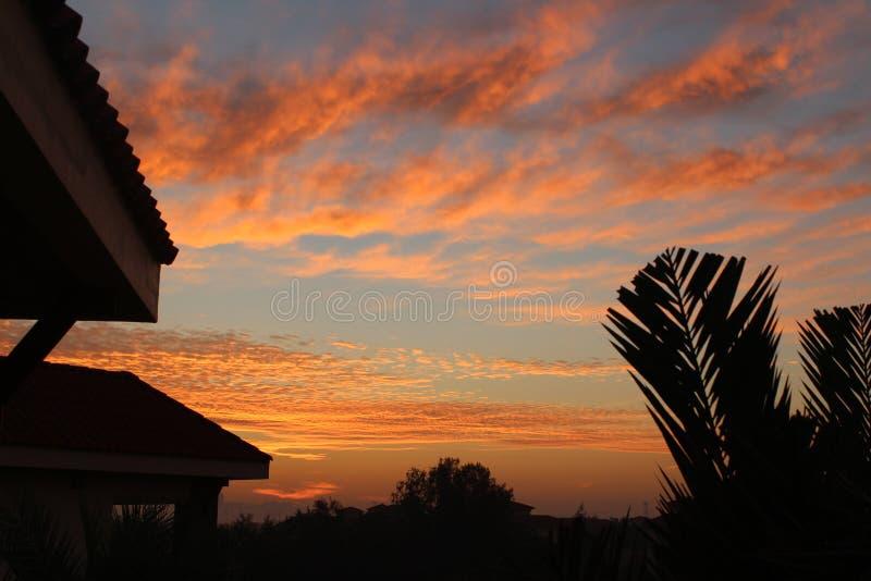 Небо восхода солнца захода солнца красивое стоковое фото rf