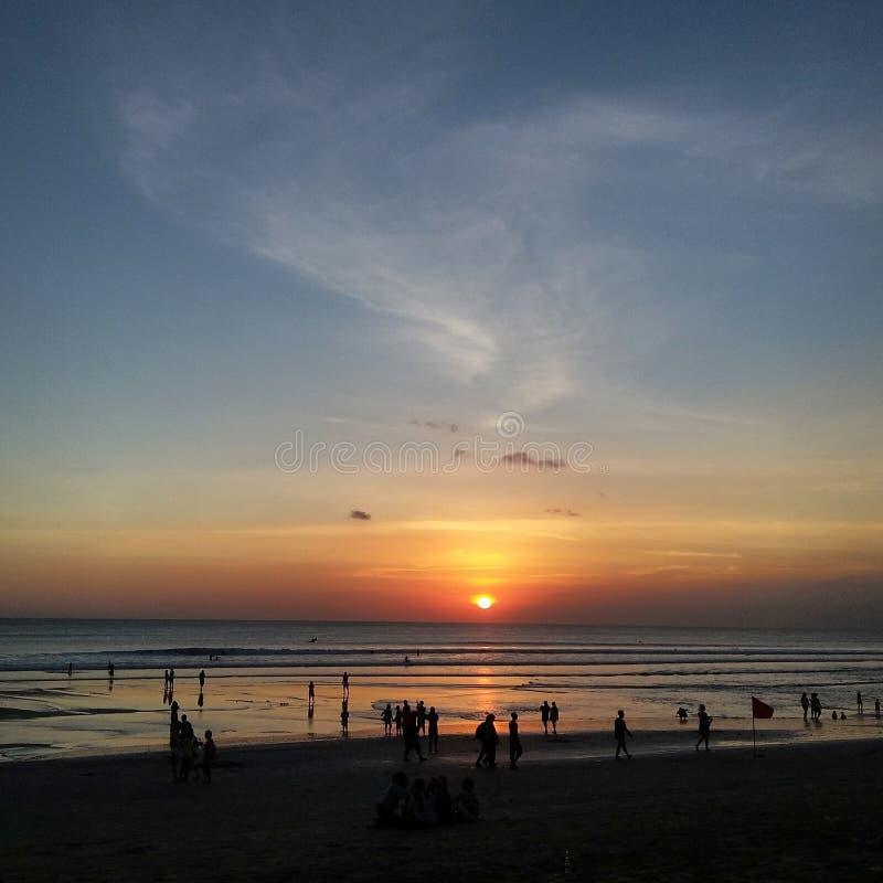 Небо солнца захода солнца голубое стоковая фотография rf