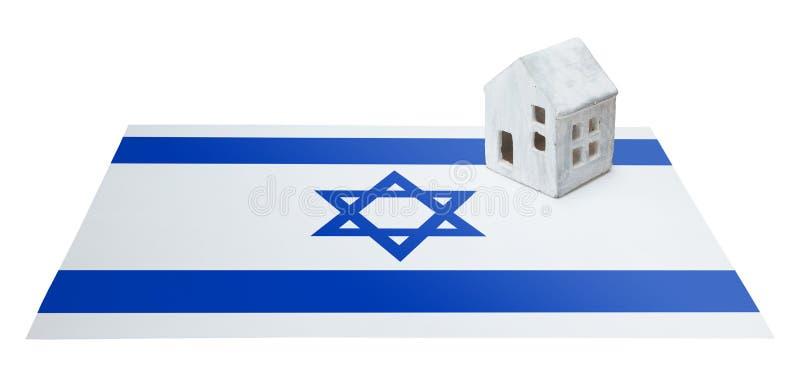 Небольшой дом на флаге - Израиль стоковая фотография rf