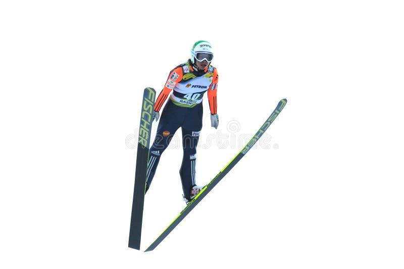 Неизвестный шлямбур лыжи состязается в дамах кубка мира прыжков с трамплина FIS 1-ого марта стоковые изображения