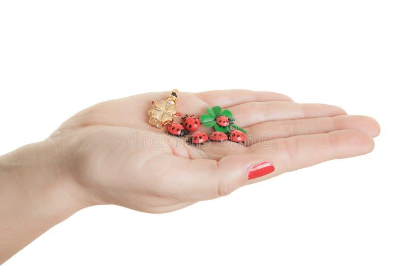 Некоторые удачливые шармы как подарок на канун Новых Годов, изолированный на белой предпосылке стоковые изображения