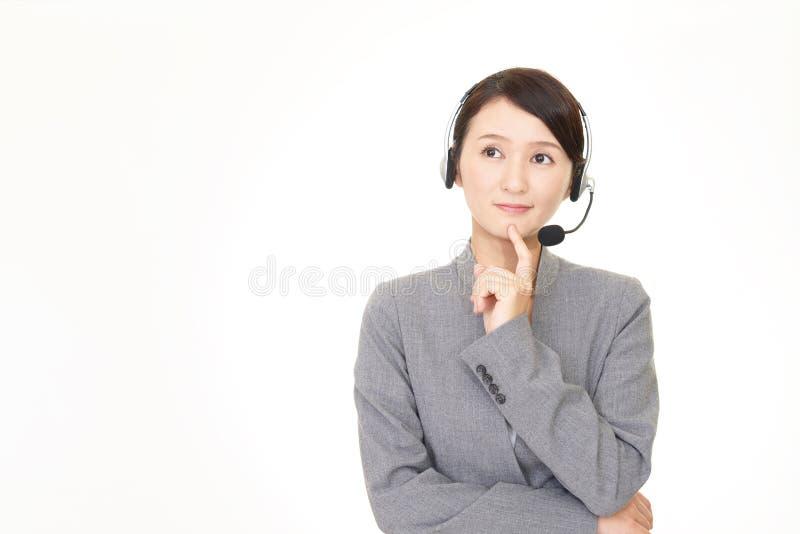Неловкий оператор центра телефонного обслуживания стоковое изображение rf