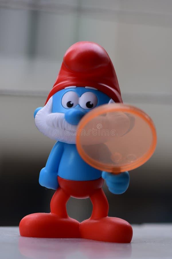 Немногое голубое Smurfs, папа Smurf стоковая фотография rf