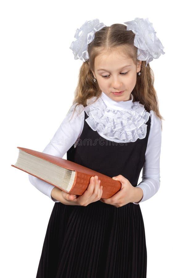 Немногое милая школьница представляя на белой предпосылке стоковая фотография rf